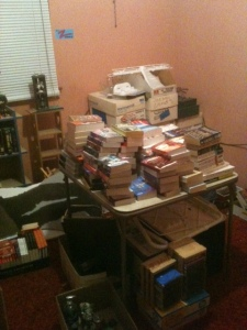 "This is my over flow ""library""  The boxes in the back are more books."