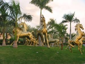 Golden Horse sculptures in front of the Al Qasr Hotel